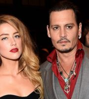 "TORONTO, ON - SEPTEMBER 14:  Actors Amber Heard (L) and Johnny Depp attend the ""Black Mass"" premiere during the 2015 Toronto International Film Festival at The Elgin on September 14, 2015 in Toronto, Canada.  (Photo by Jason Merritt/Getty Images)"