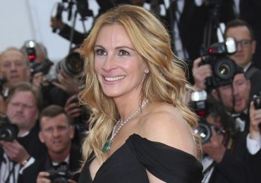 "FILE - In this Thursday, May 12, 2016, file photo, Actress Julia Roberts poses for photographers upon arrival for the screening of the film Money Monster at the 69th international film festival, Cannes, southern France. Roberts is more than just a ""Pretty Woman."" People magazine has named her the ""World's Most Beautiful Woman"" announced Wednesday, April 19, 2017. (AP Photo/Joel Ryan, File)"