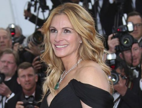 """FILE - In this Thursday, May 12, 2016, file photo, Actress Julia Roberts poses for photographers upon arrival for the screening of the film Money Monster at the 69th international film festival, Cannes, southern France. Roberts is more than just a """"Pretty Woman."""" People magazine has named her the """"World's Most Beautiful Woman"""" announced Wednesday, April 19, 2017. (AP Photo/Joel Ryan, File)"""